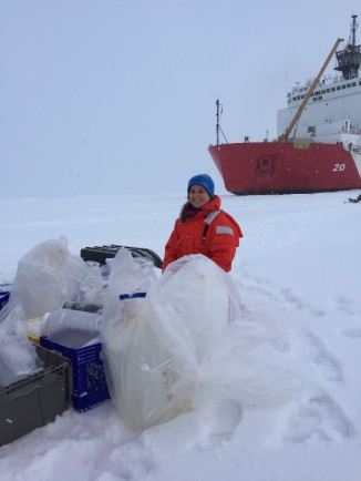 Organizing sample containers to collect melt water and seawater from a hole drilled in the ice (that's me!)
